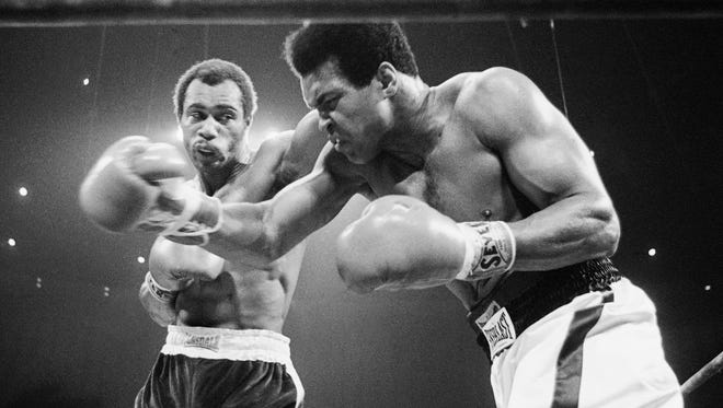Muhammad Ali, right, winces as Ken Norton hits him with a left to the head during their rematch at the Forum in Inglewood, Calif.  in 1973. Norton, a former heavyweight champion, has died, his son said