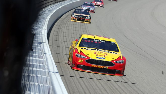NASCAR Sprint Cup Series driver Joey Logano, front, races during the FireKeepers Casino 400 on June 12, 2016, at Michigan International Speedway.