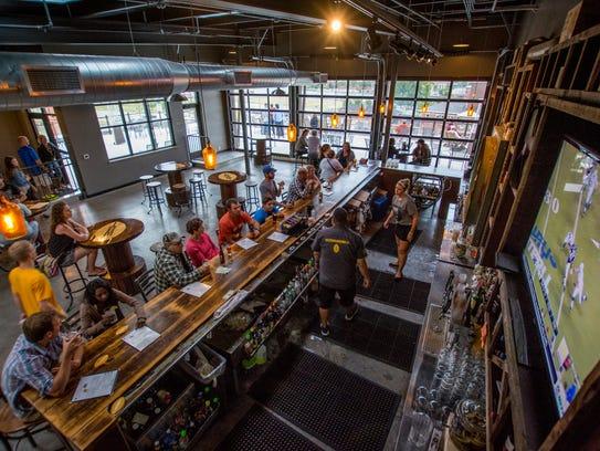Patrons enjoy their drinks inside Titletown Roof Tap,