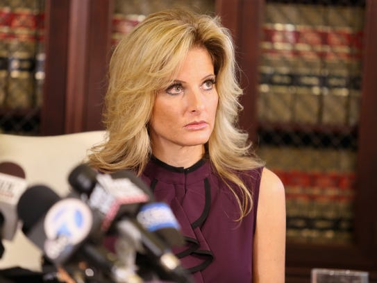 "Summer Zervos, a former candidate on ""The Apprentice,"" speaks to the media with her attorney Gloria Allred on Oct. 14, 2016, in Los Angeles."