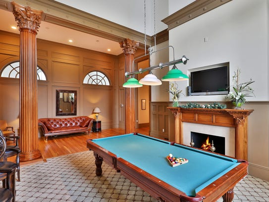 Entertain guests in the billiard room inside the clubhouse,