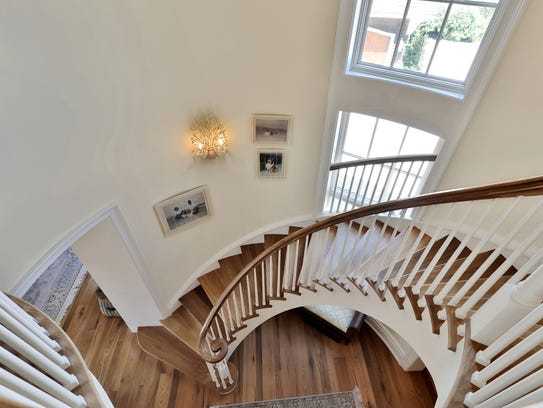 A spiral staircase with over-sized windows for those