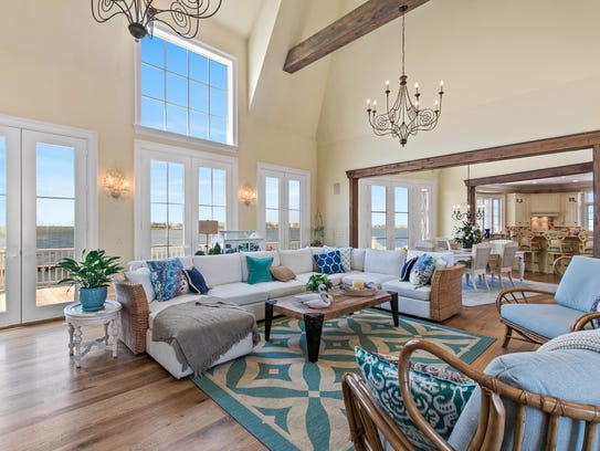 Three sets of French doors give this room the perfect