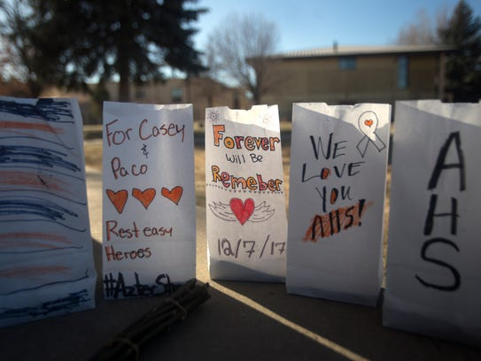A makeshift memorial is pictured on Monday at Aztec High School.
