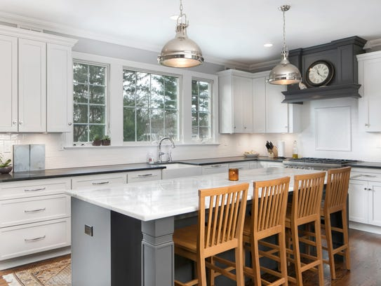 The kitchen offers custom cabinetry an expansive center island.