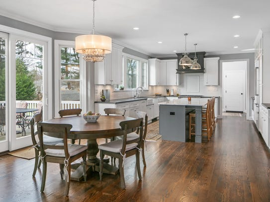 The kitchen offers oversized sliders with hardwood flooring throughout the first floor.