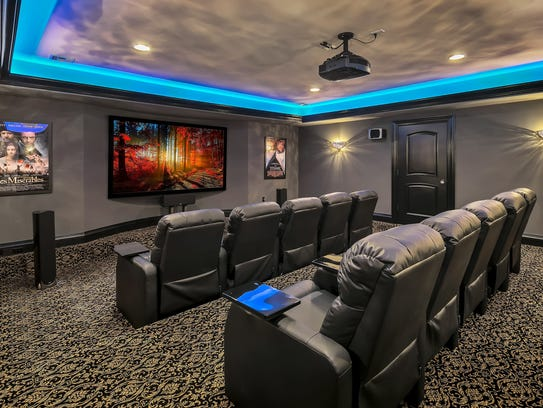 The home features personal theater with reclined seats