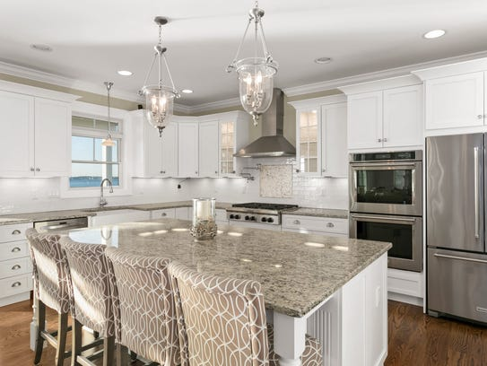 The designers kitchen offers stainless steel appliances