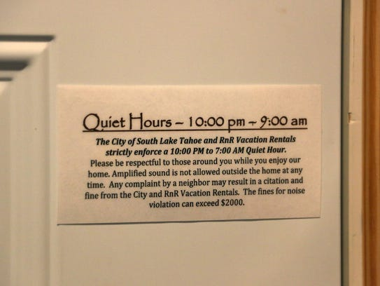 A sign is seen on the door of one of RnR Vacation Rentals'