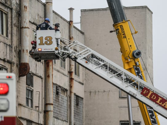 A worker is evacuated after a scissor lift fall at