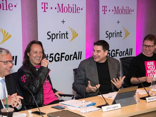 Sprint President Michel Combes, from left, T-Mobile