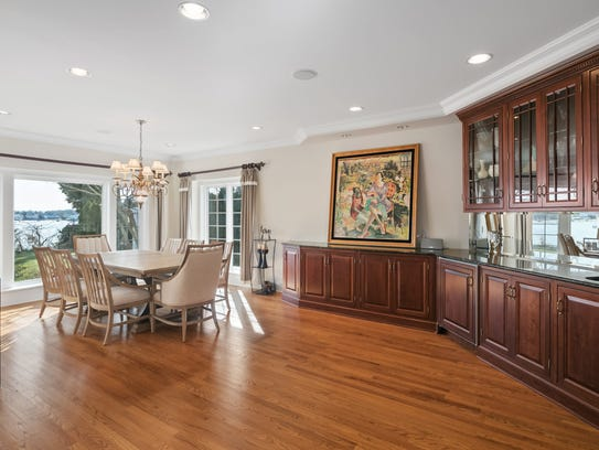 The dining room offers a wet bar with granite stone countertops.