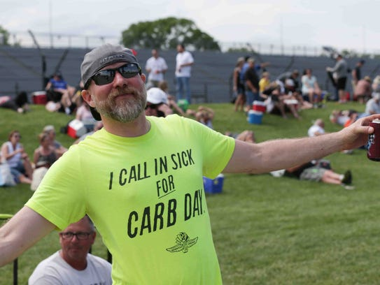 A fan shows off his Carb Day couture during Miller