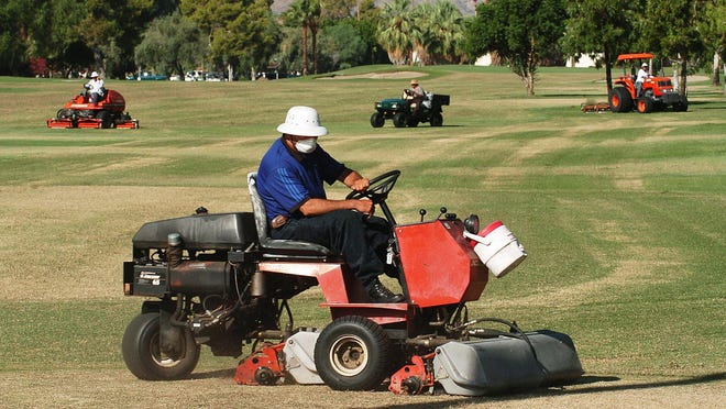 A crew scalps part of Tahquitz Creek golf resort in Palm Springs in this file photo. The city of Palm Springs will overseed some areas with winter grass this year.