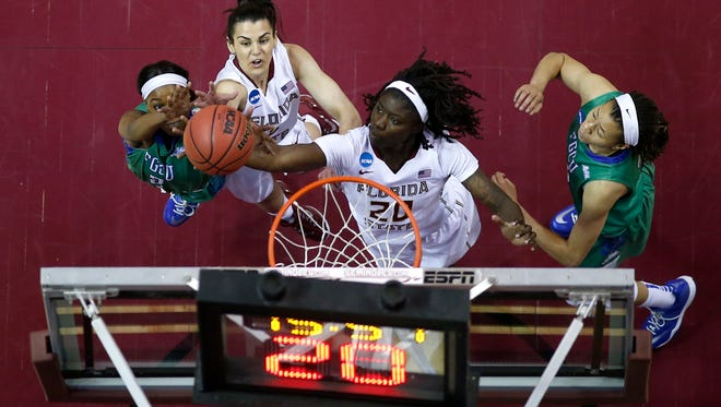 FSU's Leticia Romero and Shakayla Thomas battle Florida Gulf Coast's Kaneisha Atwater for a rebound during their round-two NCAA Tournament game at the Civic Center on Monday.