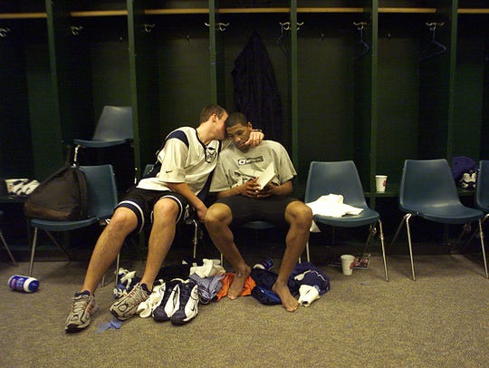 Jason Myers (left) consoles LaVall Jordan in the locker