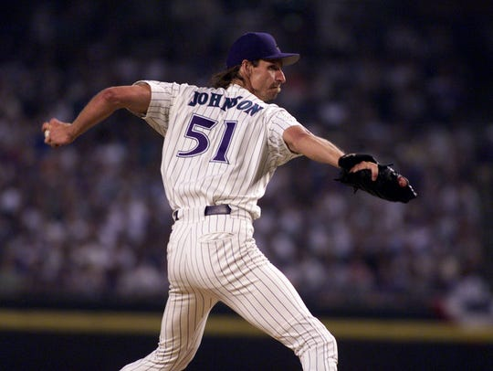 Randy Johnson throws the first pitch of the first game of the 1999 playoffs against the New York Mets.
