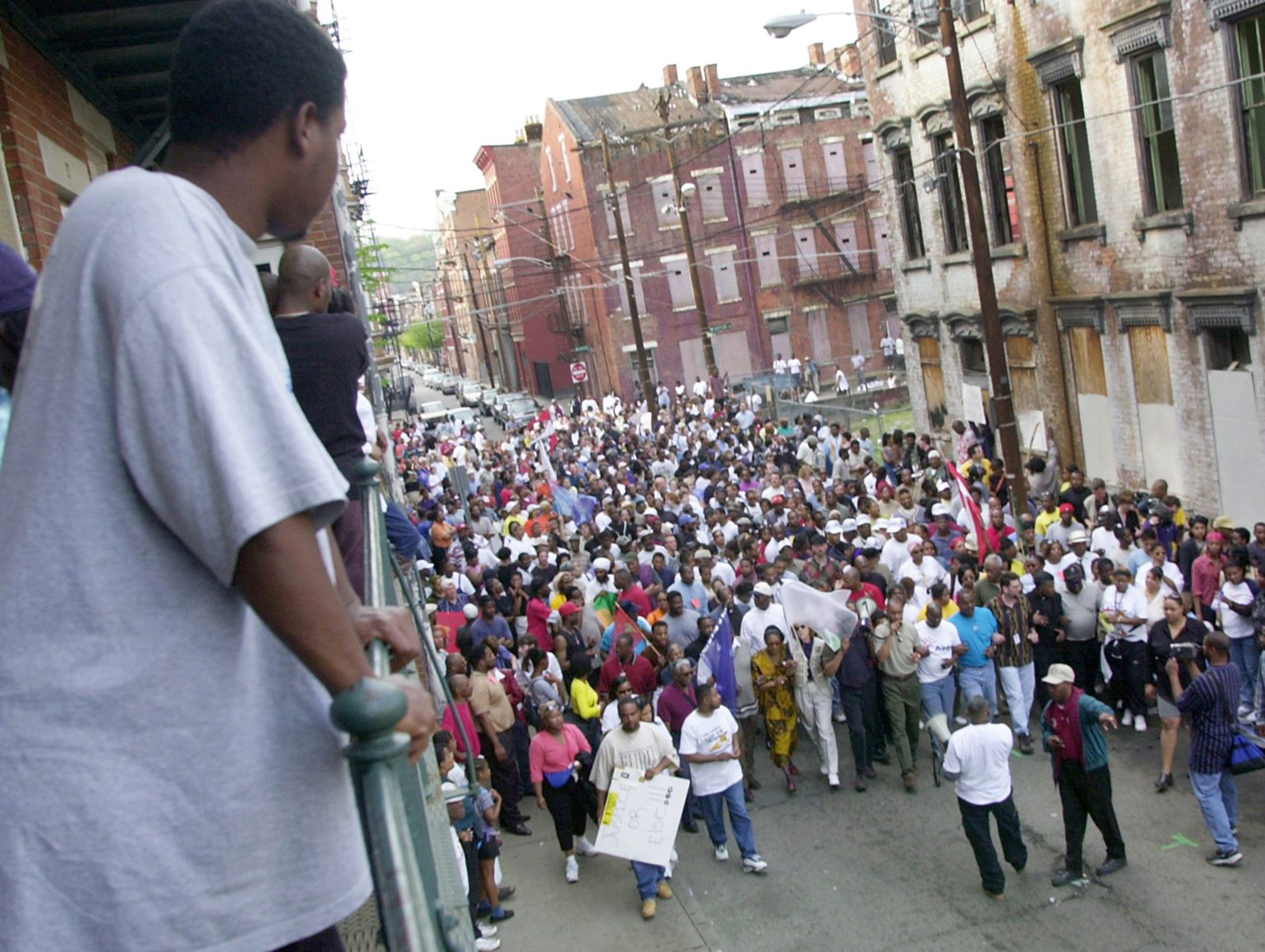 Marchers proceed along Republic Street at 13th street