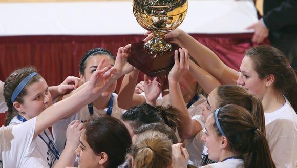 Haldane girls basketball players celebrate with the