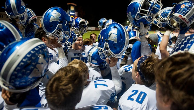 Walled Lake Western celebrates its 37-7 win in the 2016 Kensington Lakes title game in Brighton.