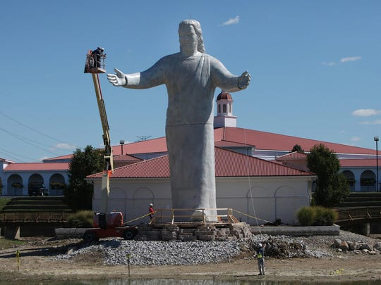 A new Jesus statue was constructed at Monroe's Solid Rock Church after the previous one caught fire after being struck by lightning.