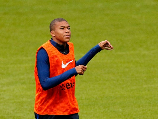 France's Kylian Mbappe, warms up during a training session at the Stade de France stadium in Saint Denis, north of Paris, France, Wednesday, Aug. 30, 2017. France will play against Netherlands during their World Cup Group A qualifying soccer match on Thursday, Aug.31. (AP Photo/Christophe Ena)