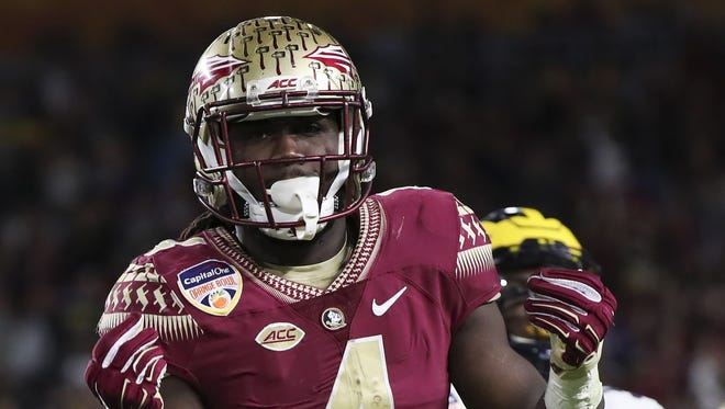 Florida State Seminoles running back Dalvin Cook (4) celebrates after a catch in the first quarter against the Michigan Wolverines at Hard Rock Stadium.