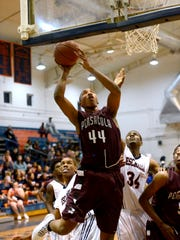 Pensacola High School's Davonchae Bryant goes in for