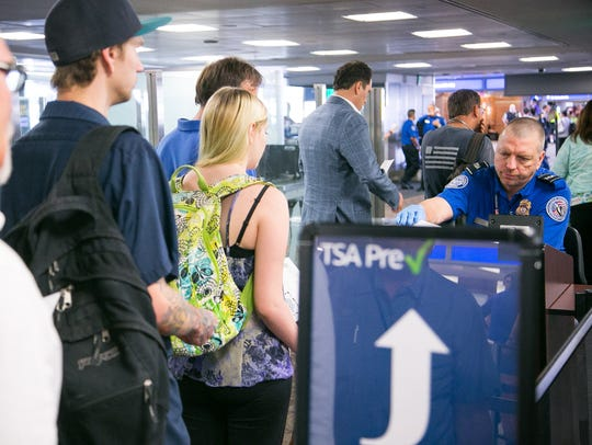 Passengers have their boarding passes and IDs checked