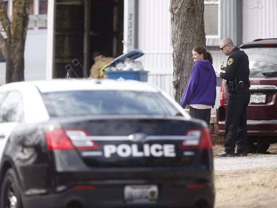 Police interview Stacey Herman at the scene of a shooting