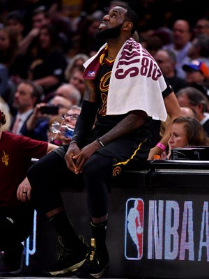 LeBron James sits on the bench during the fourth quarter against the Golden State Warriors in Game 4.