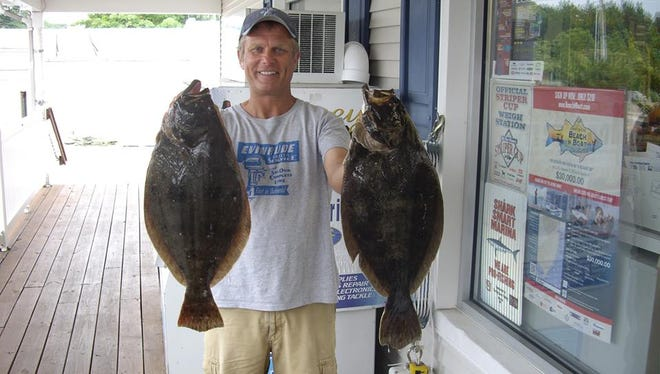 John Howell holds two summer flounder that weighed more than 5.5 pounds each.