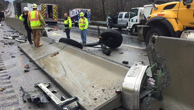 Southbound I-83 near Loganville was closed for hours April 7 after a tractor-trailer struck the jersey barrier in heavy rain.