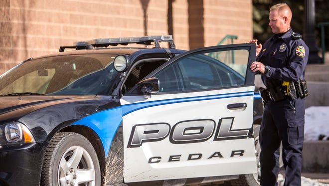 Officer Ryan Coleman of the Cedar City Police Department leaves the office to go out on patrol, Wednesday, Jan. 13, 2016.