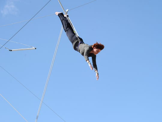 Carolyn Hennesy on a trapeze.