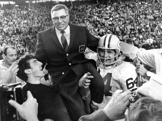 Packers coach Vince Lombardi is carried off the field by Jerry Kramer after Green Bay defeats the Oakland Raiders in Super Bowl II on Jan. 14, 1968.