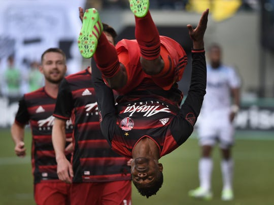 Portland Timbers forward Dairon Asprilla flips after scoring a goal during the second half of an MLS soccer game against the Vancouver Whitecaps in Portland, Ore., on Sunday, May 22, 2016. (AP Photo/Steve Dykes)