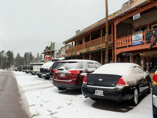 Cars covered in snow in the Village of Cloudcroft Wednesday. The small mountain community was under a winter weather advisory until Thursday.