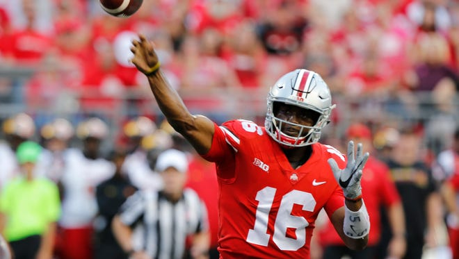 Ohio State quarterback J.T. Barrett has thrown 16 touchdown passes and only one interception, but just as importantly, is showing faith in his young receiving corps.