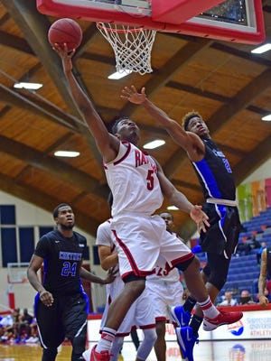 Cheyney's Dikemba Amugo, right,  is too far to block Chris Nwandu, of Shippensburg on Saturday. The Red Raiders won, 79-57, to extend their winning streak to seven games.