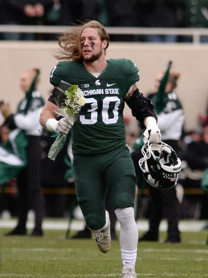 Senior linebacker Riley Bullough is honored for Senior Day before the game against Ohio State on Saturday, Nov. 19, 2016 at Spartan Stadium in East Lansing.