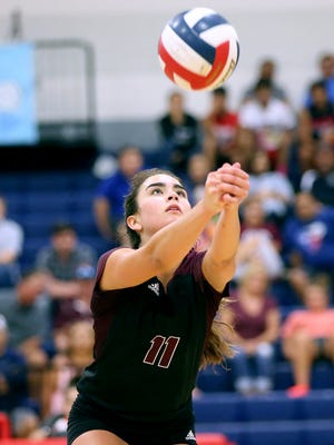 London's Sara Humpal hits the ball over against Tuloso-Midway during the CCISD McDonald's SpikeFest Championship game on Saturday, Aug. 12, 2017, at Veterans Memorial High School in Corpus Christi.