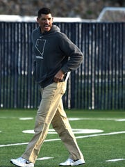 Jay Norvell runs his team through a spring camp practice earlier this month.
