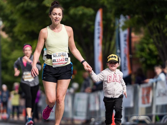 Megan Saienni of Middletown celebrates Mother's Day by being joined by her 3-year-old son, Luca, as she completes the Delaware Half-Marathon.