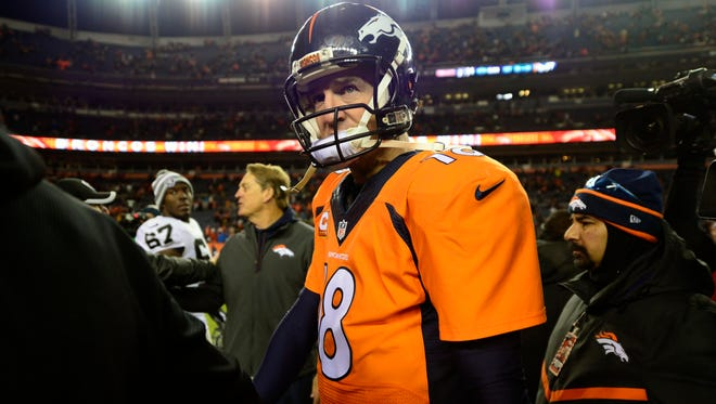 Denver Broncos quarterback Peyton Manning leaves the field following the win against the Oakland Raiders at Sports Authority Field at Mile High in Denver on Dec. 28. The Broncos defeated the Raiders 47-14.