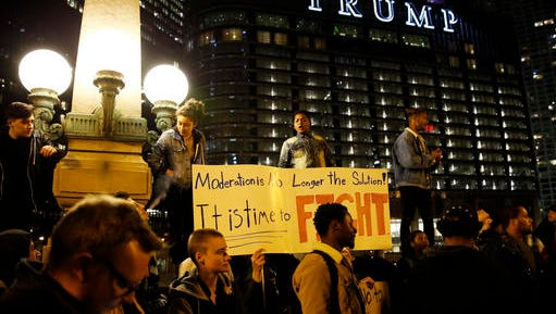 Protesters gather in downtown Chicago as they protest the election of President-elect Donald Trump, Thursday, Nov. 10, 2016. Two days after Trump's election as president, the divisions he exposed only showed signs of widening as many thousands of protesters flooded streets across the country to condemn him.