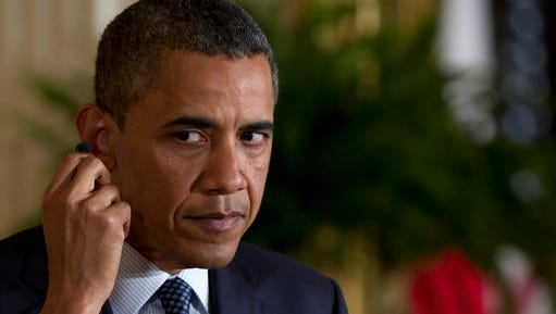 """FILE - In this April 30, 2012, file photo, President Barack Obama adjusts his ear piece during his joint news conference with Japanese Prime Minister Yoshihiko Noda in the East Room of the White House in Washington. Spotify has posted a position of President of Playlists that seems to be a perfect fit for Obama. Requirements for the position include """"at least eight years experience running a highly-regarded nation"""" and a Nobel Peace Prize. Spotify Founder and CEO Daniel Ek tweeted it to Obama on Monday, Jan. 9, 2017."""