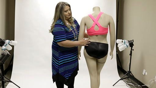 In this Oct. 29, 2014 photo, Jessica Asmar, owner of Feel Foxy, repositions a mannequin wearing a pair of padded panties in the studio at her Katy, Texas warehouse. Asmar says 2014 has been its best year since launching nearly a decade ago. Sales are up 40 percent from a year ago. (AP Photo/Pat Sullivan)