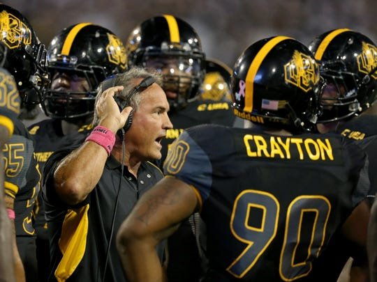 Southern Miss Golden Eagles head coach Jay Hopson talks to his players in the first half against the UTEP Miners at M. M. Roberts Stadium. Mandatory Credit: Chuck Cook-USA TODAY Sports
