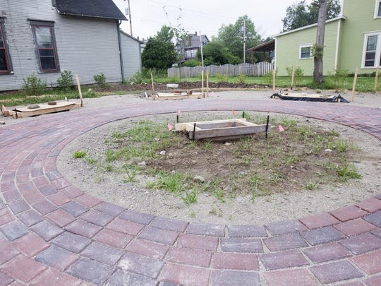 Brick paths make up the lot for Community Circle park at Main and Cherry streets in this photo from June. The park is on the site where a dilapidated house was razed.